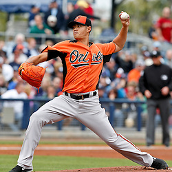 Mar 2, 2013; Port Charlotte, FL, USA; Baltimore Orioles starting pitcher Wei-Yin Chen (16) throws against the Tampa Bay Rays during the bottom of the first inning of a spring training game at Charlotte Sports Park. Mandatory Credit: Derick E. Hingle-USA TODAY Sports