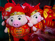 05 FEBRUARY 2019 - BANGKOK, THAILAND:  Plush toy pigs for sale at Chinese New Year souvenir stand on Yaowarat Road in Bangkok. Chinese New Year celebrations in Bangkok started on February 4, 2019, although the city's official celebration is February 5 - 6. The coming year will be the Year of the Pig in the Chinese zodiac. About 14% of Thais are of Chinese ancestry and Lunar New Year, also called Chinese New Year or Tet is widely celebrated in Chinese communities in Thailand.       PHOTO BY JACK KURTZ