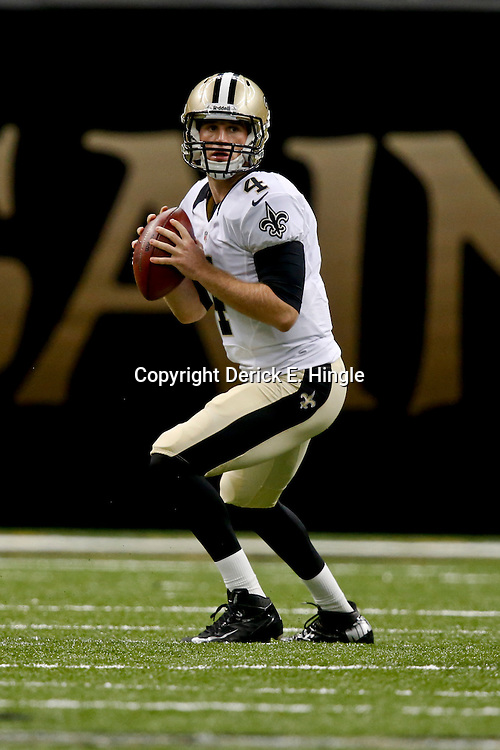 Aug 16, 2013; New Orleans, LA, USA; New Orleans Saints quarterback Ryan Griffin (4) against the Oakland Raiders during the second half of a preseason game at the Mercedes-Benz Superdome. The Saints defeated the Raiders 28-20. Mandatory Credit: Derick E. Hingle-USA TODAY Sports