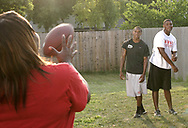 Natasha White (left) passes a football with her sons Terrence Talbott and Terry Talbott, Jr. (right,)  Sunday August 12, 2007.