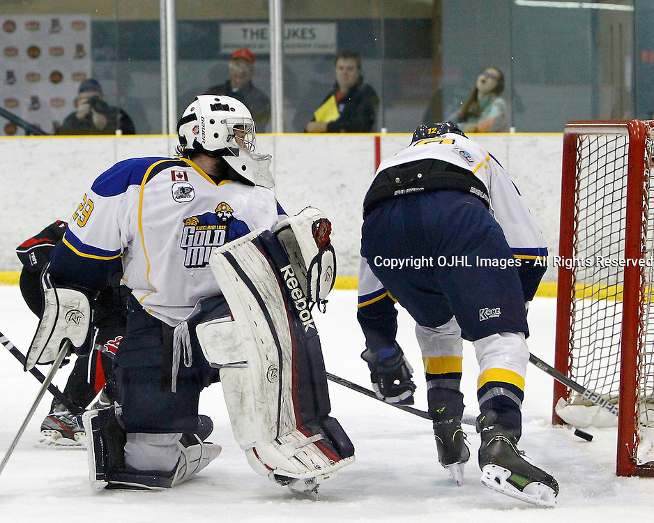 WELLINGTON, ON - May 1 : Dudley Hewitt Cup, Central Canadian Jr &quot;A&quot; Championship, Kirkland Lake Gold Miners and the Fort Frances Lakers, Jeremy Pominville #29 of the Kirkland Lake Gold Miners watches Ethan Strong #12 of the Kirkland Lake Gold Miners try and knock the puck out of the goal during first period game action.<br /> (Photo by Brian Watts / OJHL Images)