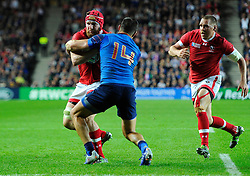 Remy Grosso of France tackles Kyle Gilmour of Canada  - Mandatory byline: Joe Meredith/JMP - 07966386802 - 01/10/2015 - Rugby Union, World Cup - Stadium:MK -Milton Keynes,England - France v Canada - Rugby World Cup 2015