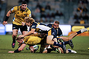 Gareth Evans tackled during the Super Rugby match, Brumbies V Hurricanes, GIO Stadium, Canberra, Australia, 30th June 2018.Copyright photo: David Neilson / www.photosport.nz