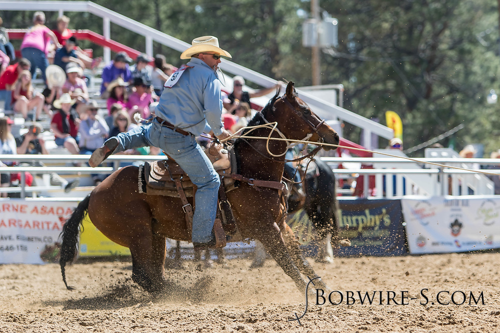 Tie-down roper Joe Colletti makes his run in the first performance of the Elizabeth Stampede on Saturday, June 2, 2018.