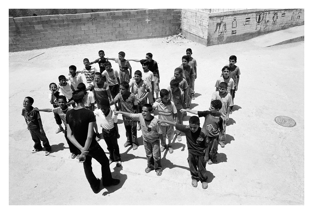 Young boys get a disciplinary work-out in the  Re-education centre at Askar refugee camp. Nablus, Palestine, 2007