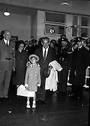 Princess Grace & Prince Rainier visit.  A smiling Prince Rainier, one arm around daughter Caroline's shoulder arrives at Dublin Airport..20.08.1963