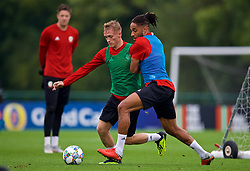 CARDIFF, WALES - Monday, September 3, 2018: Wales' Matthew Smith (left) and captain Ashley Williams during a training session at the Vale Resort ahead of the UEFA Nations League Group Stage League B Group 4 match between Wales and Republic of Ireland. (Pic by David Rawcliffe/Propaganda)