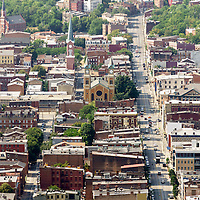 Aerial photo of Cincinnati Over-The-Rhine neighborhood buildings and Churches along Vine Street an Race Street facing North from downtown Cincinnati. Over-The-Rhine (OTR) is a Historic District and is listed on the US National Register of Historic Places. Photo is vertical, high resolution and was taken in 2012.