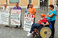 Roma 13 Settembre 2012. ''A.A.A. disabili veri cercano politici.Massima riservatezza. No perditempo''.Manifestazione dell'associazione Tutti a scuola, onlus che si occupa di disabili in piazza Montecitorio contro la decisione che l'indennita' di accompagnamento.diventi reddito nella revisione dell'Isee.