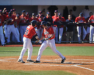Ole Miss' Will Allen (30) hits a two run home run and is congratulated by Andrew Mistone (25) vs. Rhode Island at Oxford-University Stadium in Oxford, Miss. on Sunday, February 24, 2013. Ole Miss won 5-3 to improve to 7-0.