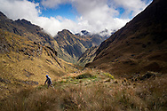 """Man hikes just past """"Dead Woman's Pass"""" on Inca Trail in Peru."""