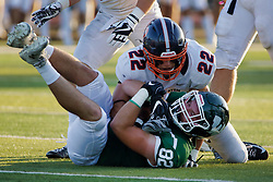 {BLOOMINGTON, IL: Daniel Herber ends the advance of Anthony Ryan during a college football game between the IWU Titans  and the Wheaton Thunder on September 15 2018 at Wilder Field in Tucci Stadium in Bloomington, IL. (Photo by Alan Look)