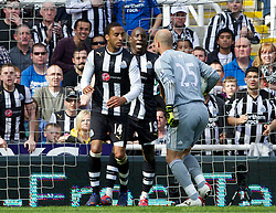 NEWCASTLE-UPON-TYNE, ENGLAND - Sunday, April 1, 2012: Liverpool's goalkeeper Jose Reina argues with Newcastle United's James Perch and Demba Ba, which leads to his sending off, during the Premiership match at St James' Park. (Pic by Vegard Grott/Propaganda)