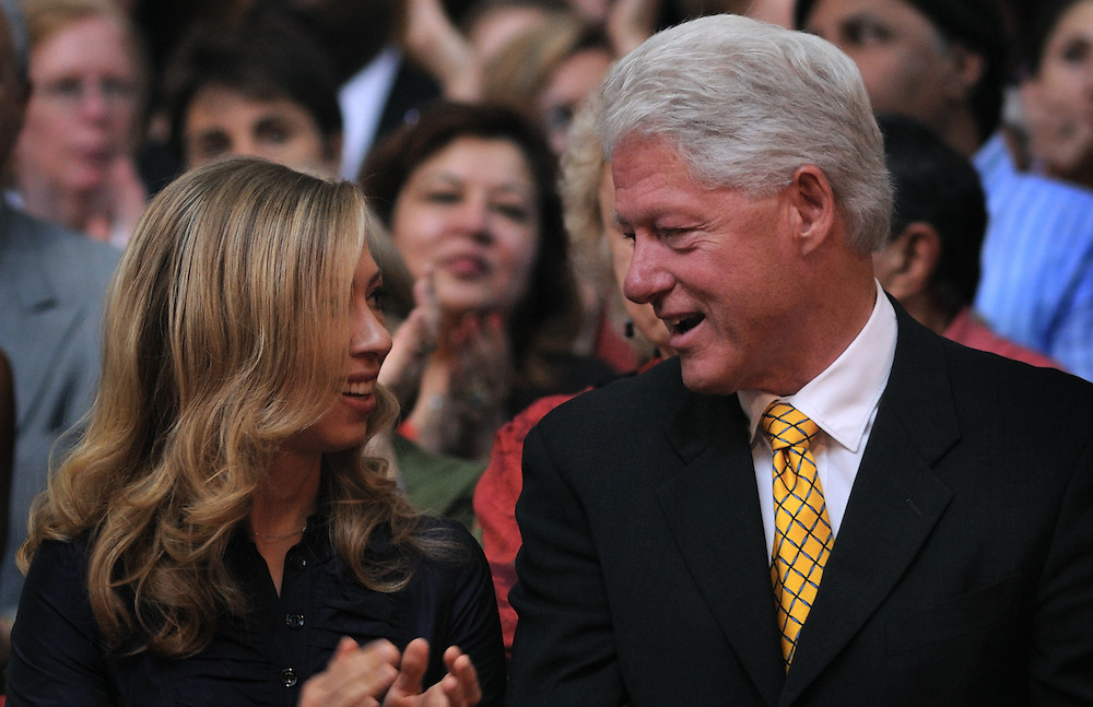 Chelsea Clinton and her father President Bill Clinton exchange glances at an event in Washington, D.C.  Photo by Johnny Bivera