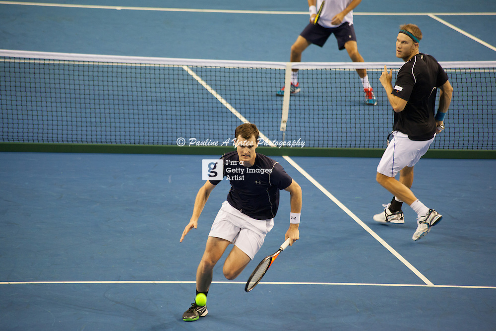 Jamie Murray races for the ball to return to the Bryan Brothers as Dominic Inglot looks on