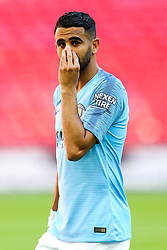Riyad Mahrez of Manchester City  looks on as Manchester City celebrate winning the Community Shield with a 2-0 victory over Chelsea - Rogan/JMP - 05/08/2018 - FOOTBALL - Wembley Stadium - London, England - Chelsea v Manchester City - The FA Community Shield.
