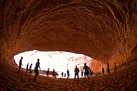 Group of people playing volleyboall in Redwall Cavern while rafting the Grand Canyon. Grand Canyon National Park, AZ.