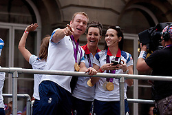 © Licensed to London News Pictures. 10/09/2012. LONDON, UK. Olympic gold medal winning cyclists, Sir Chris Hoy (L), Rebecca Romero (C) and Victoria Pendelton (R) are seen near Bank Station in London today (10/09/12) as they take part in a parade for British Olympic and Paralympic medalists. Photo credit: Matt Cetti-Roberts/LNP