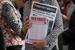 © Licensed to London News Pictures . 27/09/2017. Brighton, UK. A conference delegate holds a Labour Party Marxist newspaper, with Isreal related headline, on day 4 of the 2017 the Labour Party Conference, held at The Brighton Centre in East Sussex. Photo credit: Ben Cawthra/LNP