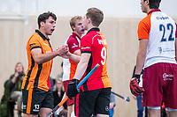 DELFT - Benjamin Stanzl (Oranje-Rood)  met Jim van de Venne (Oranje-Rood) tijdens de zaalhockey hoofdklasse competitiewedstrijd Oranje Rood-Almere . COPYRIGHT KOEN SUYK