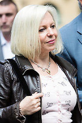 © Licensed to London News Pictures. 02/06/2014. London, UK. Rolf Harris's daughter Bindi Harris arrives with Artist and television personality, Rolf Harris (not shown) at Southwark Crown Court in London on 2nd June 2014. Rolf Harris denies 12 counts of indecent assault against four girls and women between 1968 and 1986. Photo credit : Vickie Flores/LNP