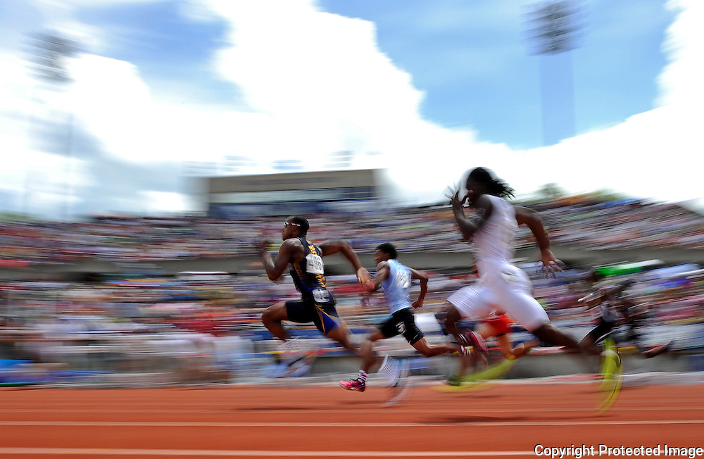 Kris Wilson/News Tribune<br /> John Moten of John Burroughs surges ahead of Grandview's Jaymes Kelly near the halfway point in the Class 3 boys 100-meter dash final during the MSHSAA Track and Field Championships at Lincoln University's Dwight T. Reed Stadium.