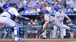 June 20, 2017 - Kansas City, MO, USA - The Boston Red Sox's Jackie Bradley Jr. scores before the tag from Kansas City Royals catcher Salvador Perez on a double by Sam Travis in the fourth inning at Kauffman Stadium in Kansas City, Mo., on Tuesday, June 20, 2017. (Credit Image: © John Sleezer/TNS via ZUMA Wire)