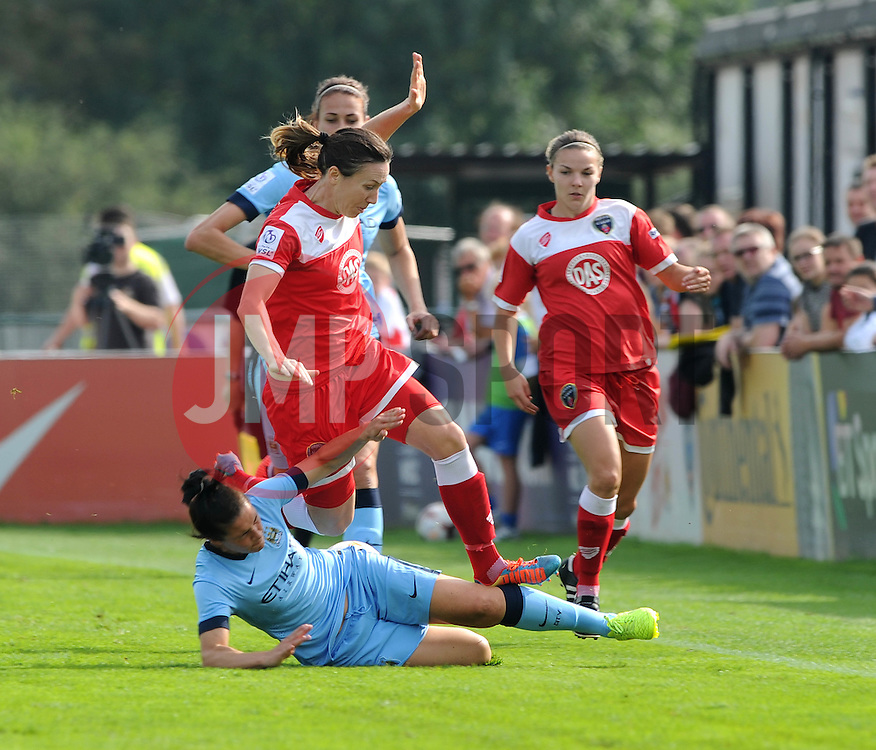 Bristol Academy Womens' Corinne Yorston is tackled by Manchester City Womens' Nicola Harding - Photo mandatory by-line: Dougie Allward/JMP - Mobile: 07966 386802 - 28/09/2014 - SPORT - Women's Football - Bristol - SGS Wise Campus - Bristol Academy Women's v Manchester City Women's - Women's Super League