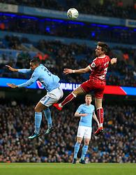 Joe Bryan of Bristol City battles for the high ball with Danilo of Manchester City  - Mandatory by-line: Matt McNulty/JMP - 09/01/2018 - FOOTBALL - Etihad Stadium - Manchester, England - Manchester City v Bristol City - Carabao Cup Semi-Final First Leg