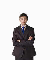 Businessman with arms crossed on white background portrait