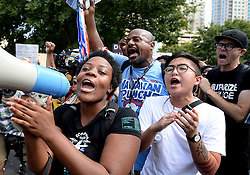 Protesters chant, front/left/right, as a man yells the name of Jesus, center, outside Bank of America Stadium Sunday, September 25, 2016 in Charlotte, NC, USA. The Carolina Panthers hosted the Minnesota Vikings in NFL action. Photo by Jeff Siner/Charlotte Observer/TNS/ABACAPRESS.COM