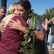 PTA President for Marjory Stonemason Douglas Kim Potanovic receives a hug from Ron Panzo, founder of Lei of Aloha,  the day when students and parents came for campus orientation at the Marjory Stoneman Douglas high school for reopening following last week's mass shooting in Parkland, Florida, U.S., February 25, 2018. Attendance was voluntary but hundreds of students and parents showed up. The school opens this coming Wednesday. Seventeen persons including students and staff were murdered in the shooting. REUTERS/Angel Valentin