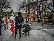 "A Chinese-speaking tourist, dressed in traditional ""furisode"" kimono, for single women, adopts a classical pose for a snapshot at Kiyomizu Temple in Kyoto, Japan.  Donning traditional Japanese clothing is particularly popular with tourist from the Chinese mainland."