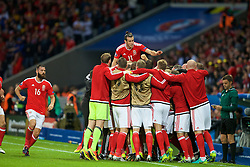 5LILLE, FRANCE - Friday, July 1, 2016: Wales' Gareth Bale jumps in celebration as the payers, substitutes and staff celebrate the goal by captain Ashley Williams to make the score 1-1 during the UEFA Euro 2016 Championship Quarter-Final match against Belgium at the Stade Pierre Mauroy. (Pic by Paul Greenwood/Propaganda)