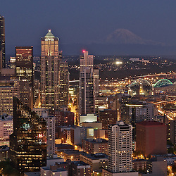 An evening view of the Seattle skyline and Mt. Rainier from the Space needle. Seattle, Washington.