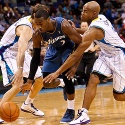 February 1, 2011; New Orleans, LA, USA; Washington Wizards point guard John Wall (2) attempts to dribble past New Orleans Hornets point guard Jarrett Jack (2) and center Aaron Gray (34) during the third quarter at the New Orleans Arena. The Hornets defeated the Wizards 97-89.  Mandatory Credit: Derick E. Hingle