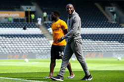Benik Afobe of Bristol City arrives for the Sky Bet Championship fixture against Hull City and talks to Nouha Dicko of Hull City - Mandatory by-line: Robbie Stephenson/JMP - 24/08/2019 - FOOTBALL - KCOM Stadium - Hull, England - Hull City v Bristol City - Sky Bet Championship