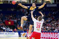 Alberto Entrerrios of Spain vs Kasper Nielsen of Denmark during handball match between Denmark and Spain in 1st Semifinal at 10th EHF European Handball Championship Serbia 2012, on January 27, 2012 in Beogradska Arena, Belgrade, Serbia. (Photo By Vid Ponikvar / Sportida.com)