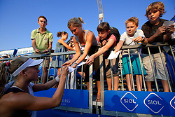 Johanna Larsson of Sweden with her fans after she won at 2nd Round of Singles at Banka Koper Slovenia Open WTA Tour tennis tournament, on July 22, 2010 in Portoroz / Portorose, Slovenia. (Photo by Vid Ponikvar / Sportida)