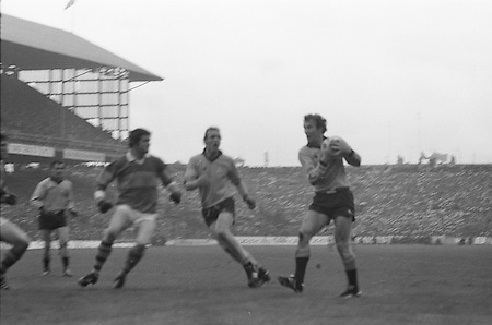 Dublin clings to the ball tightly as Kerry comes towards him from the side during the All Ireland Senior Gaelic Football Final, Kerry v Dublin in Croke Park on the 28th September 1975. Kerry 2-12 Dublin 0-11.