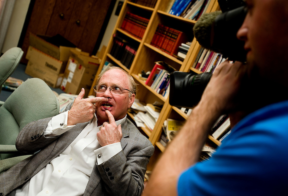 010610        Brian Leddy.KOAT Channel 7 photojournalist Chris Fullam photographs Gallup Independent publisher Bob Zollinger on Wednesday during an interview at the paper. Zollinger was involved with an altercation with Mayor Harry Mendoza downtown earlier during the day.