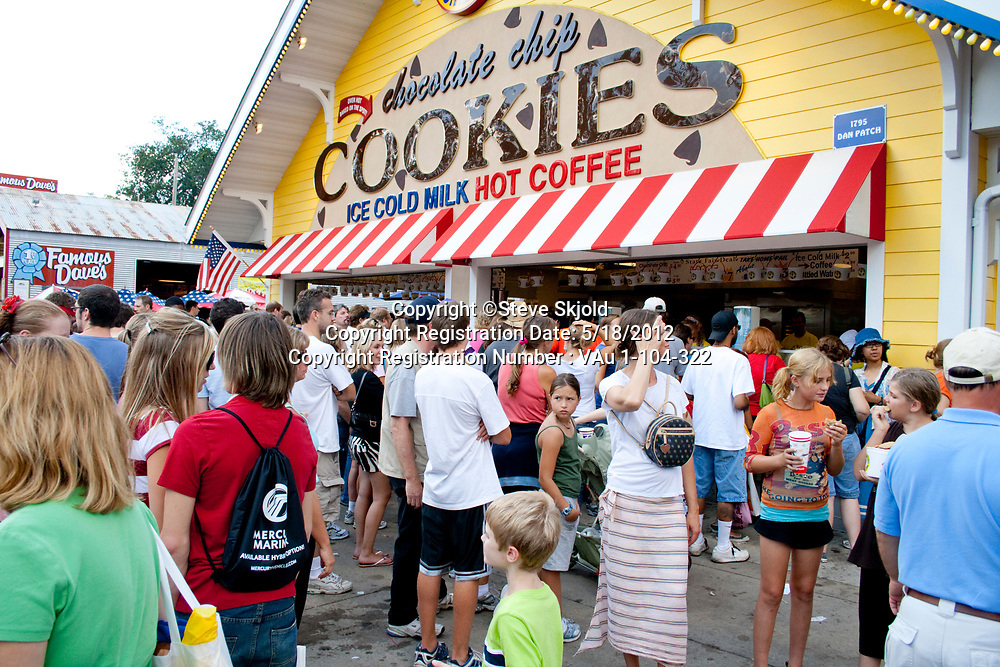 Long lines waiting at the chocolate chip cookies shop along with milk and coffee. Minnesota State Fair St Paul Minnesota MN USA