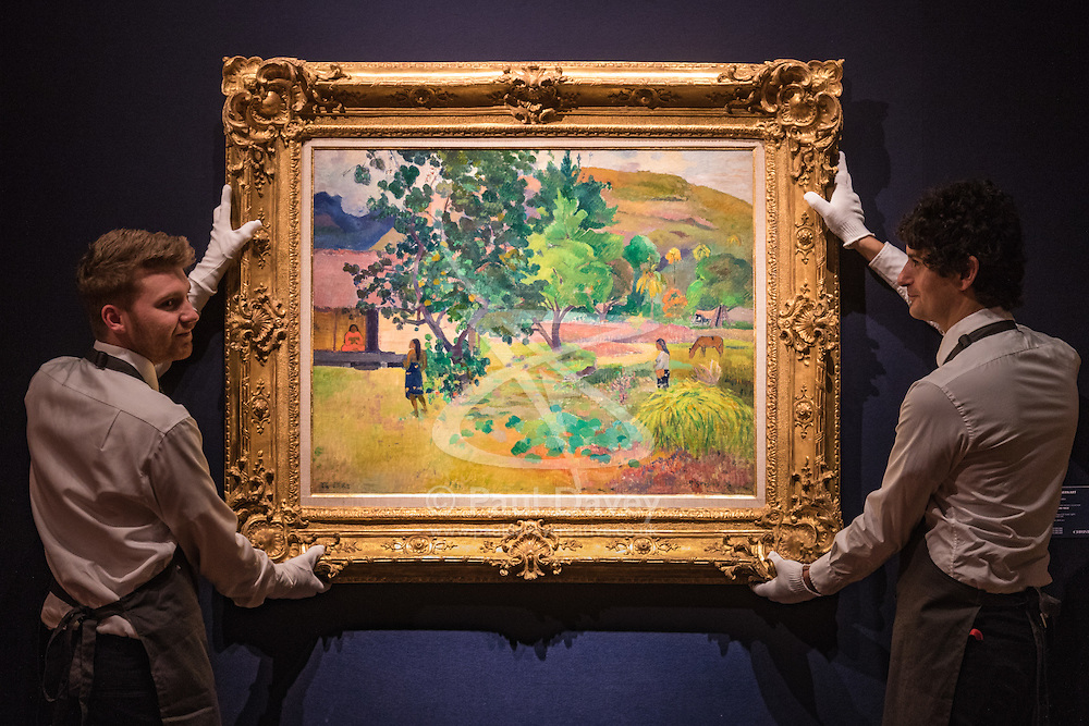 Christie's, London, February 24th 2017. Fine art auctioneers Christie's hold a press preview for their Impressionist and Modern Art and Art of the Surreal sale which takes place on 28th February. Christie's, London, February 24th 2017. Fine art auctioneers Christie's hold a press preview for their Impressionist and Modern Art and Art of the Surreal sale which takes place on 28th February. PICTURED: Gallery technicians hang Paul Gauguin's Te Fare (La maison) painted in 1892, which has an estimate of between £12-18 million.