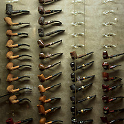 May 3, 2012 - Manhattan, NY : An assortment of pipes line a display case at De L:a Concha, tobacconist and smoking lounge, located at 1390 Avenue of the Americas. CREDIT : Karsten Moran for The New York Times
