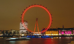 (c) London News Pictures. 01/12/2010.  London Eye turned red to mark World AIDS Day. The Eye is one of more than 80 landmarks across 13 countries that are turning red today to promote awareness of the ongoing fight against AIDS. Picture caption should read Will Oliver/London News Pictures