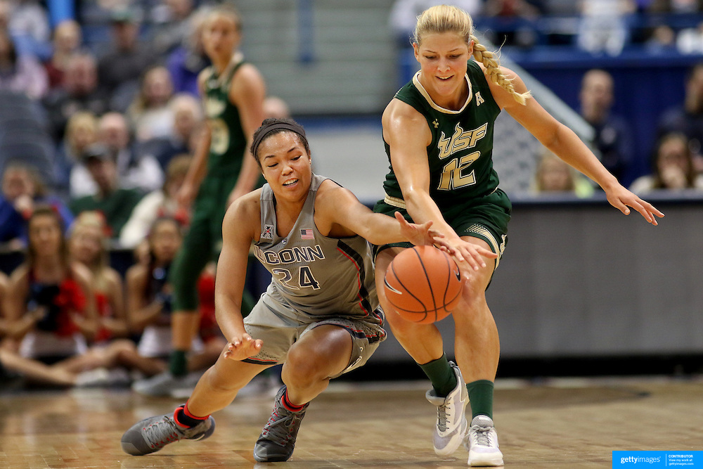 HARTFORD, CONNECTICUT- JANUARY 10: Napheesa Collier #24 of the Connecticut Huskies pulls in a loose ball while challenged by Maria Jespersen #12 of the South Florida Bulls during the the UConn Huskies Vs USF Bulls, NCAA Women's Basketball game on January 10th, 2017 at the XL Center, Hartford, Connecticut. (Photo by Tim Clayton/Corbis via Getty Images)
