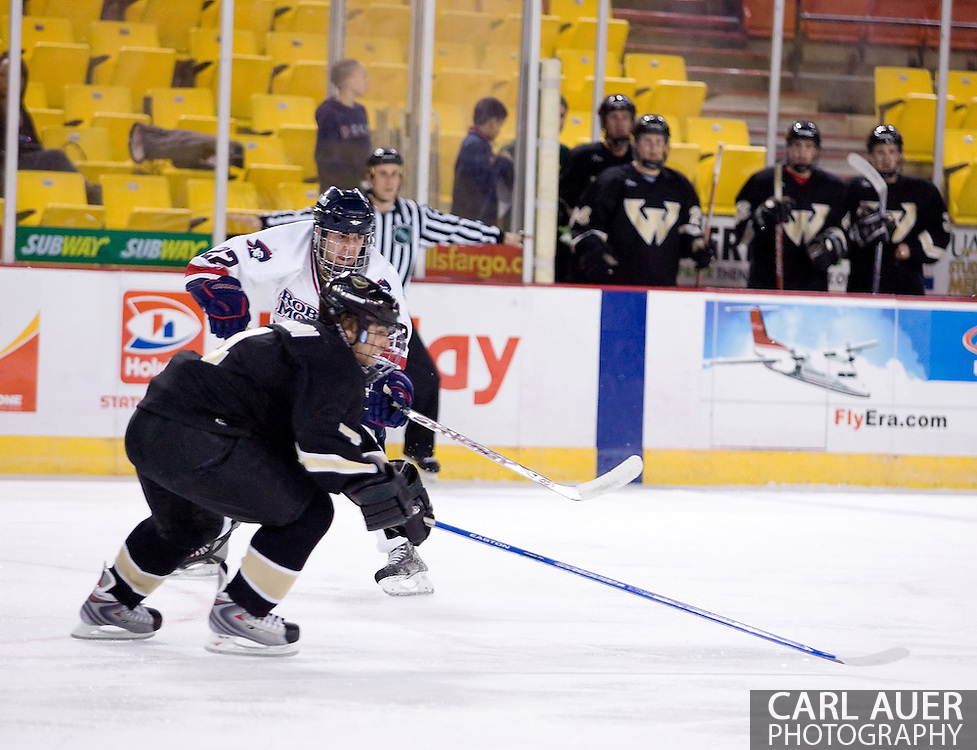 October 13, 2007 - Anchorage, Alaska: Sean Berkstresser (22) of the Robert Morris Colonials makes a pass past Ryan Bernardi (4) of the Wayne State Warriors in the Colonials 4-1 victory over the Warriors at the Nye Frontier Classic at the Sullivan Arena.