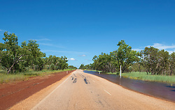 Groundwater lies on the road near a depth marker on the highway to Fitzroy Crossing.
