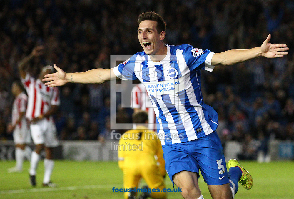 Lewis Dunk of Brighton and Hove Albion celebrates after he scores the opening goal during the Capital One Cup match at the American Express Community Stadium, Brighton and Hove<br /> Picture by Paul Terry/Focus Images Ltd +44 7545 642257<br /> 12/08/2014
