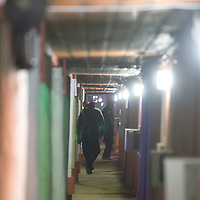 Cops investigate a crime scene at the Hacienda Motel in Gallup Friday,